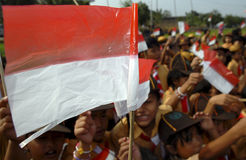 CHILDREN FLAG PARTY. Students carry Indonesian National Flag Sang Dwi Warna at an outing class in Solo, Java, Indonesia Stock Image