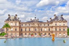 Children float  boats in the  fountain Luxembourg Palace Royalty Free Stock Photography
