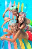 Children on float in pool Royalty Free Stock Image