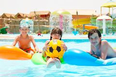 Children floating on pool toys Royalty Free Stock Image