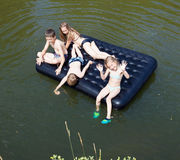 Children floating on the river Royalty Free Stock Photography