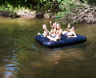 Children floating on the river Stock Photography