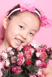 Children and flowers Royalty Free Stock Photography