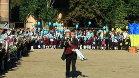Children with flowers and balloons on a holiday of the 1st september stock footage