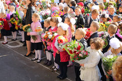 Children with flowers in front of the School No. 1349 Royalty Free Stock Photos