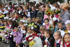 Children with flowers in front of the School No. Royalty Free Stock Photo