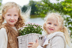 Children with flowers in garden stock images