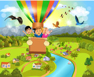 Children flying with the balloon. Happy children flying with a hot air balloon above a rural landscape Stock Photography