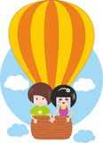 Children flying on hot air balloon Stock Photos
