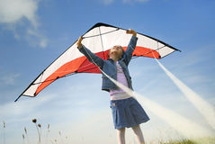 Children flying with a kite. Children dreaming to fly with a kite stock photo