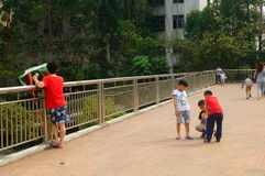 The children are flying kites on the bridge. Stock Image