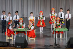 Children in folk costume performs on stage Royalty Free Stock Photos