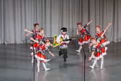 Children in folk costume performs on stage Stock Photography