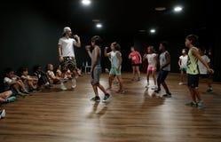 Funk dance masterclass for children during summer camp activities. Children follow their teacher while they improve their dance during a funk dance masterclass stock image