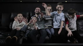 The children are fooling in the cinema stock video