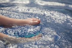 Children foot swimming pool background. Day light stock image