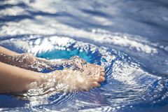 Children foot swimming pool background. Day light royalty free stock photography