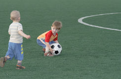 Children on a football field Royalty Free Stock Photography