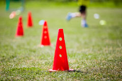 Children football practice training. Soccer football practice training with obstructions, markers and flags Royalty Free Stock Image