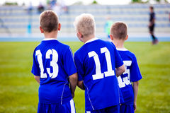 Children football soccer match. Team waiting on a bench Royalty Free Stock Photos