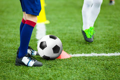 Children Football Soccer Training. Young Athlete with Football Ball. On Pitch. Kids in Soccer Uniform Kicking Ball. Boy Practice Dribbling Drills on Sport Grass stock photos