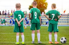 Children Football Team. Young Boys Watching Soccer Match royalty free stock image