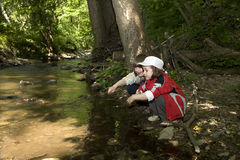 Children by the forest creek Royalty Free Stock Image