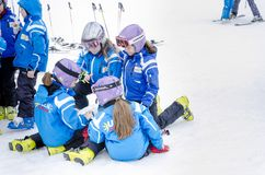 Children form ski school team groups during the annual winter school holiday. BANSKO, BULGARIA - circa OCTOBER, 2015: Bulgarian children form ski school team Royalty Free Stock Images