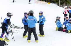 Children form ski school team groups during the annual winter school holiday. BANSKO, BULGARIA - circa OCTOBER, 2015: Bulgarian children form ski school team Stock Images