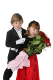 Children in formal clothes. Cute children in formal clothes with large bouquet of red roses Royalty Free Stock Photo