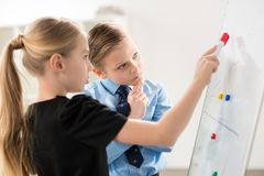 Children in formal clothes. Making presentation, children in business concept royalty free stock photo