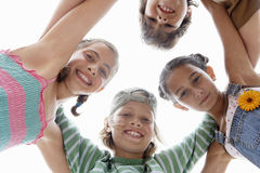 Children Forming Huddle Against Sky Royalty Free Stock Photography