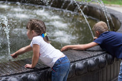 Children at the fountain Royalty Free Stock Photo