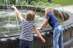 Children at the fountain Royalty Free Stock Image