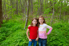 Children friend girls playing on the jungle park forest Royalty Free Stock Image