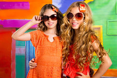 Children friends  girls in vacation at tropical colorful house. Children friends girls with fashion sunglasses in vacation at tropical colorful house Royalty Free Stock Photography