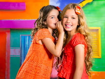 Children friends girls in vacation at tropical colorful house Royalty Free Stock Images