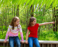 Children friends playing pointing finger to jungle park Royalty Free Stock Photography
