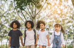 Children Friendship hold hand Together. Children Friendship Togetherness Smiling Happiness Concept.Cute african american little boy and girl walking and hold stock images