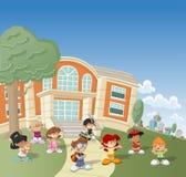 Children in front of school Stock Images