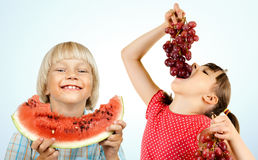 Children and fruit Stock Image