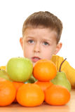 Children and fruits Stock Images