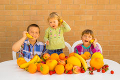 Children and fruits Stock Photography