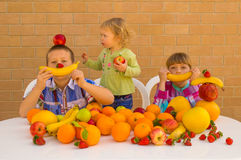 Children and fruits Stock Image