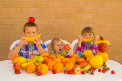 Children and fruits Stock Photo