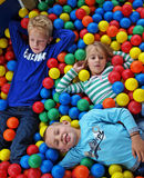 Children in fun balls. Young boys and a girl in colorful balls Royalty Free Stock Images