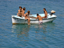 Children in fun on the boat. Boy and girls enjoy on boat in crystal clear Adriatic sea Croatia - Dalmatia Stock Image