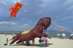 Children fun with huge horse kite Stock Photos