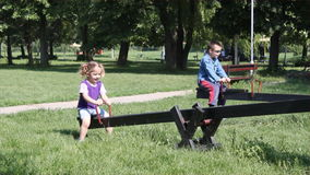 Children fun on seesaw stock video