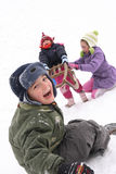 Children fun on the snow Royalty Free Stock Photo